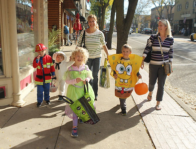 Candace H. Johnson-For Shaw Media Sisters Donna Plath, of Antioch and Karen Crabb, of Aurora and their their children walk to different businesses offering candy in downtown Antioch during Treat the Streets for Harvest Fest in Antioch. (10/19/19)