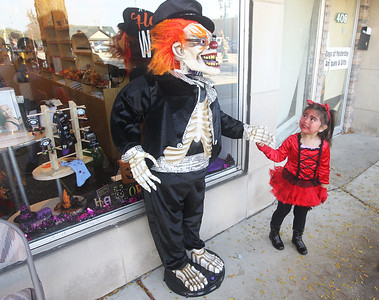 """Candace H. Johnson-For Shaw Media Allison Gabino, 3, of Antioch checks out, """"Mr. Bones,"""" outside of the Merle Norman Cosmetics store as she walks down the street getting candy from businesses during Treat the Streets for Harvest Fest in downtown Antioch. (10/19/19)"""