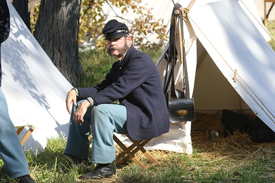 Candace H. Johnson-For Shaw Media Mike Draper, of Troy, Mo., portrays a Union soldier with the 10th Illinois Company H as he waits to go into battle against the Confederates in the Battle of Atlanta during Hainesville's annual Civil War Encampment & Battle at the Northbrook Sports Club in Hainesville. (10/20/19)