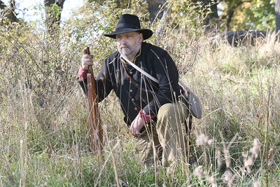 Candace H. Johnson-For Shaw Media Jim Spray, of Bristol, Wis., portrays a Union soldier with the 2nd Regiment Kentucky Volunteer Cavalry, as he waits in the field before the start of the Battle of Atlanta during Hainesville's annual Civil War Encampment & Battle at the Northbrook Sports Club in Hainesville. (10/20/19)