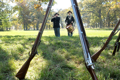 Candace H. Johnson-For Shaw Media Muskets stand close by as Steven Skalak, of Westchester and his brother, Kevin, portray soldiers with the 104th Illinois as they play fife and drum music during Hainesville's annual Civil War Encampment & Battle at the Northbrook Sports Club in Hainesville. (10/20/19)