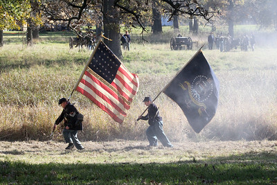 Candace H. Johnson-For Shaw Media Union soldiers carry their flags away from the fighting in the Battle of Atlanta during Hainesville's annual Civil War Encampment & Battle at the Northbrook Sports Club in Hainesville. (10/20/19)