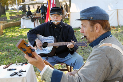 "Candace H. Johnson-For Shaw Media Jim Schranz, of Lindenhurst and David Corbett, of Buffalo Grove with the Battlefield Balladeers play a Civil War era song titled, ""Ring the Banjo,"" during Hainesville's annual Civil War Encampment & Battle at the Northbrook Sports Club in Hainesville. (10/20/19)"