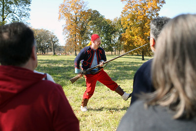 Candace H. Johnson-For Shaw Media Chris Dosch, of Aurora portrays a Zouave soldier as he talks to the crowd about how soldiers used a musket during Hainesville's annual Civil War Encampment & Battle at the Northbrook Sports Club in Hainesville. (10/20/19)