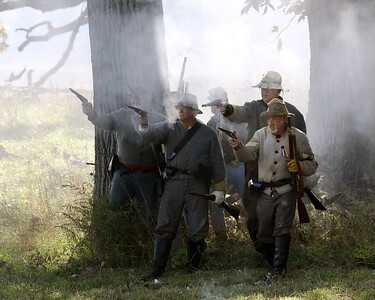 Candace H. Johnson-For Shaw Media Confederate soldiers fire their guns against Union soldiers at the Battle of Atlanta during Hainesville's annual Civil War Encampment & Battle at the Northbrook Sports Club in Hainesville. (10/20/19)