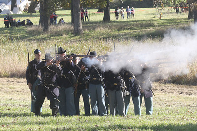 Candace H. Johnson-For Shaw Media Union soldiers fire their weapons against the Confederates in the Battle of Atlanta during Hainesville's annual Civil War Encampment & Battle at the Northbrook Sports Club in Hainesville. (10/20/19)