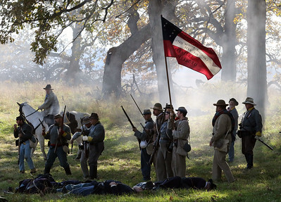 Candace H. Johnson-For Shaw Media Confederate soldiers with the 154th Senior Regiment carry their flag at the end of the Battle of Atlanta during Hainesville's annual Civil War Encampment & Battle at the Northbrook Sports Club in Hainesville. (10/20/19)