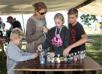 Candace H. Johnson-For Shaw Media Anastassia Strine, of Round Lake and her children, A.J., 6, Sophia, 12, and Anthony, 14, check out the smells of a Civil War hospital during Hainesville's annual Civil War Encampment & Battle at the Northbrook Sports Club in Hainesville. (10/20/19)