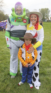 Candace H. Johnson-For Shaw Media John and Angela Greenland, of Lake Villa and their son, Gavin, 8, show off their Toy Story costumes during the Haunted Trail and Bonfire at Forest View Park in Lindenhurst. The event was hosted by the Lindenhurst Park District. (10/19/19)