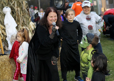 Candace H. Johnson-For Shaw Media Storyteller Paddy Lynn, of Mundelein brings the book, Heckedy Peg, to life as she gets children to act it out with her during the Haunted Trail and Bonfire at Forest View Park in Lindenhurst. The event was hosted by the Lindenhurst Park District. (10/19/19)