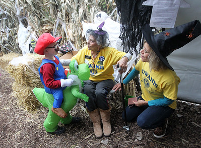 Candace H. Johnson-For Shaw Media Jack Stabile, 4, of Gurnee talks with Irene Williams, of Lindenhurst and Cindi Stoffel, of McHenry after they greeted him as he was going into the Haunted Trail during the Haunted Trail and Bonfire at Forest View Park in Lindenhurst. The event was hosted by the Lindenhurst Park District. Irene Williams started the Lindenhurst Park District in 1988. (10/19/19)