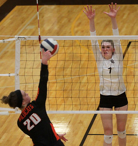 Candace H. Johnson-For Shaw Media Libertyville's Kellie Hopper makes an attack against Carmel's Riley Clark as she tries to block the shot in the second set at Carmel Catholic High School in Mundelein. Carmel won 18-25, 25-16, 25-17. (10/21/19)