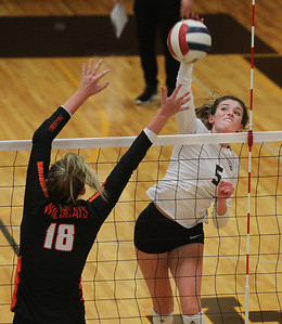 Candace H. Johnson-For Shaw Media Libertyville's Peyton O'Brien tries to block an attack by Carmel's Annie Bart in the second set at Carmel Catholic High School in Mundelein. Carmel won 18-25, 25-16, 25-17. (10/21/19)