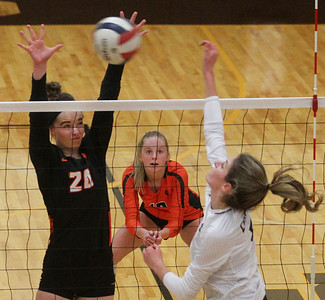 Candace H. Johnson-For Shaw Media Libertyville's Kellie Hopper tries to block an attack by Carmel's Annie Bart in the first set at Carmel Catholic High School in Mundelein. Libertyvillle's Oliva Sauers was ready on defense. Carmel won 18-25, 25-16, 25-17. (10/21/19)