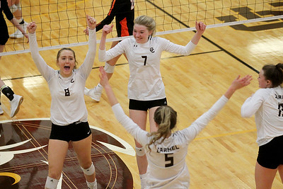 Candace H. Johnson-For Shaw Media Carmel's Mya Mainzer, Riley Clark, Annie Bart and Shannon Brennan celebrate a point against Libertyville in the third set at Carmel Catholic High School in Mundelein. Carmel won 18-25, 25-16, 25-17. (10/21/19)