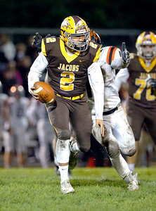 Jacobs quarterback Cole Bhardwaj scrambles with the ball during their week 9 football game against Crystal Lake Central at Jacobs High School on Friday, Oct. 25, 2019, in Algonquin.