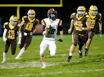 Crystal Lake Central's Jake White runs against Jacobs during their week 9 football game at Jacobs High School on Friday, Oct. 25, 2019, in Algonquin.