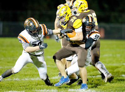 Jacobs' Jacob Mobeck, center, is tackled by Crystal Lake Central's Tyler Julitz, right, during their week 9 football game at Jacobs High School on Friday, Oct. 25, 2019, in Algonquin.