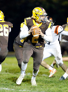 Jacobs quarterback Cole Bhardwaj looks to pass during their week 9 football game against Crystal Lake Central at Jacobs High School on Friday, Oct. 25, 2019, in Algonquin.