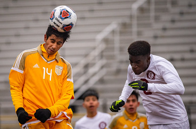 Jacobs' Tarek Shah heads the ball into the goal past Elgin's Olaoluwa Ajayi in the second half for their second score of the Class 3A Harlem Regional championship game in Rockford on Saturday, Oct. 26, 2019. Jacobs won 2-1. Randy Stukenberg for Shaw Media.