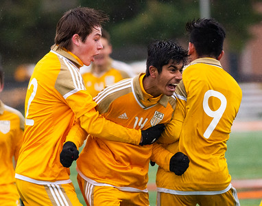 Jacobs' Tarek Shah, center, celebrates after scoring their second goal in the Class 3A Harlem Regional championship game in Rockford on Saturday, Oct. 26, 2019. Jacobs won 2-1. Randy Stukenberg for Shaw Media.