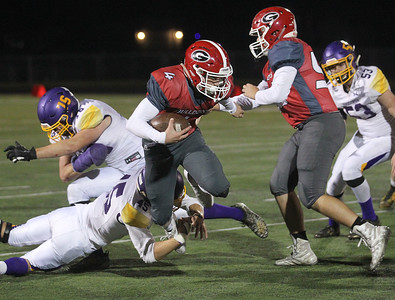 Candace H. Johnson-For Shaw Media Grant's John Bolton is tackled by Wauconda's Colin Westfall in the second quarter at Grant Community High School in Fox Lake. Wauconda won 19-6. (10/26/19)