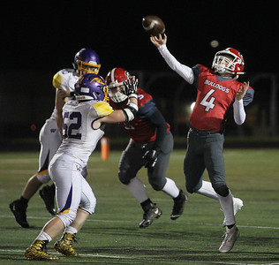 Candace H. Johnson-For Shaw Media Grant's John Bolton (#4) makes a pass against Wauconda's Michael Kloss (#52) in the fourth quarter at Grant Community High School in Fox Lake. Wauconda won 19-6. (10/26/19)