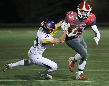 Candace H. Johnson-For Shaw Media Wauconda's Kellen Calby tackles Grant's Jimmy Taylor in the fourth quarter at Grant Community High School in Fox Lake. Wauconda won 19-6. (10/26/19)