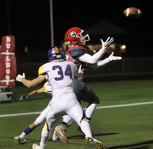 Candace H. Johnson-For Shaw Media Grant's Jimmy Taylor makes the catch for a touchdown against Wauconda's Colin Husko and Kellen Calby (#34) in the fourth quarter at Grant Community High School in Fox Lake. Wauconda won 19-6. (10/26/19)
