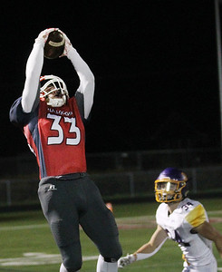 Candace H. Johnson-For Shaw Media Grant's Jimmy Taylor leaps up for the catch against Wauconda's Kellen Calby in the fourth quarter at Grant Community High School in Fox Lake. Wauconda won 19-6. (10/26/19)