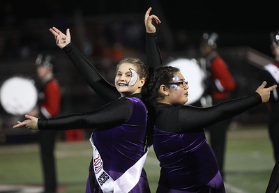 Candace H. Johnson-For Shaw Media Grant's Sarah Gallup and Stephanie Haro, in the Color Guard, perform at half-time during the varsity football game against Wauconda at Grant Community High School in Fox Lake.  (10/26/19)