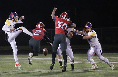 Candace H. Johnson-For Shaw Media Wauconda's Nicholas Bulgarelli's punt is blocked by Grant's Kenneth Bednarski in the first quarter at Grant Community High School in Fox Lake. Wauconda won 19-6. (10/26/19)