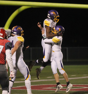 Candace H. Johnson-For Shaw Media Wauconda's Javerius McGuinn (#16) celebrates his touchdown with Vince Bennett against Grant in the third quarter at Grant Community High School in Fox Lake. Wauconda won 19-6. (10/26/19)