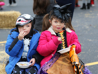 Candace H. Johnson-For Shaw Media Jay Hinks, 5, of Lake Villa and his sister, Fia, 7, enjoy eating carmel apples during Halloween Howl at the Fox Lake Police Department. (10/28/19)
