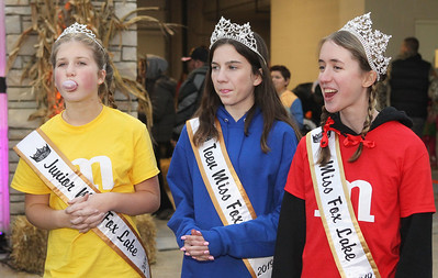 Candace H. Johnson-For Shaw Media Aleah Inman, 12, Madison Routledge, 13, and Alyia Thibault, 17, all Fox Lake 2019 queens, try to blow bubbles in the bubble gum contest during Halloween Howl at the Fox Lake Police Department. (10/28/19)