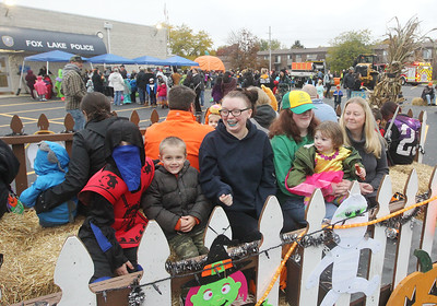 Candace H. Johnson-For Shaw Media The Cokenower family, of Fox Lake enjoys a hayride during Halloween Howl at the Fox Lake Police Department. (10/28/19)