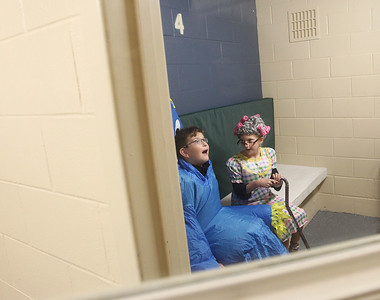 Candace H. Johnson-For Shaw Media Caden Jones, 11, of Round Lake and his sister, Hannah, 9, sit and look around a jail cell dressed for Halloween as they take a jail cell tour during Halloween Howl at the Fox Lake Police Department. (10/28/19)