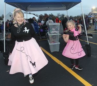 Candace H. Johnson-For Shaw Media Cindy Irwin, of Fox Lake dances with Kaylen Eveland, 7, of Richmond, both dressed in 50's costumes with poodle skirts during Halloween Howl at the Fox Lake Police Department. (10/28/19)