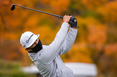 Kaneland's Cody Ganzon hits off the first tee in the Class 2A Freeport Sectional golf tournament on Monday, Oct. 12, 2020.