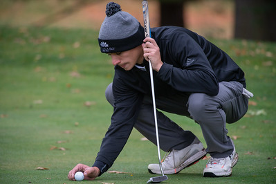 Crystal Lake South golfer Ricky Falbo places his ball on No. 8 green in the Class 2A Freeport Sectional golf tournament on Monday, Oct. 12, 2020.