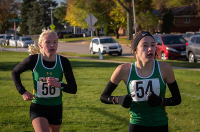 Crystal Lake South runners Isabella Gonzalez, right, and Abby Machesky near the one mile mark in the 2A Belvidere Regional XC race on Saturday, Oct. 24, 2020. Gonzalez finished first with Machesly finshing second 28 seconds later. Randy Stukenberg for Shaw Media