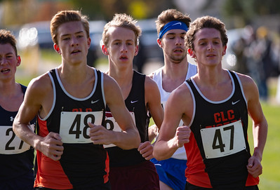 Crystal Lake Central team members Karson Hollander, 48, and Daniel Hamill run near the one mile mark in the 2A Belvidere Regional XC race on Saturday, Oct. 24, 2020. The team took first to win the 2A Regional XC title. Randy Stukenberg for Shaw Media