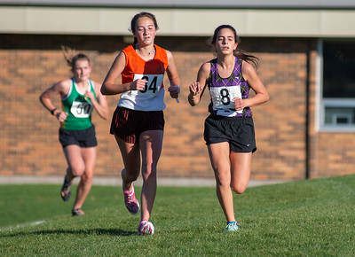 Crystal lake Central's Kylie Smith, 34, runs next to Belvidere's Nina Fiore in the 2A Belvidere Regional XC race on Saturday, Oct. 24, 2020. Fiore edged out Smith by six seconds at the finish line. Randy Stukenberg for Shaw Media