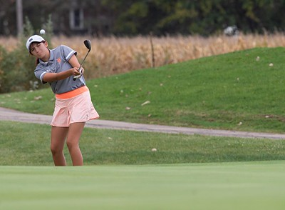 Alexis Morrow from DeKalb chips onto the No. 15 green in the Girls Class 2A Belvidere Sectional golf tournament on Monday, Oct. 4, 2021 at Timber Pointe Golf Club near Poplar Grove. Randy Stukenberg for Shaw Media