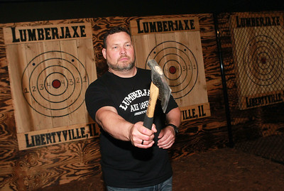 Candace H. Johnson-for Shaw Media Jason Wright, of Libertyville, owner, shows how to hold a hatchet before throwing it at a target during the grand opening of the Lumberjaxe Axe Lounge on Peterson Road in Libertyville.  (10/1/21)
