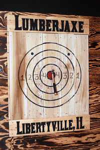 Candace H. Johnson-for Shaw Media A hatchet thrown by Jason Wright, of Libertyville, owner, lands on the bullseye during the grand opening of the Lumberjaxe Axe Lounge on Peterson Road in Libertyville. A second location for the Lumberjaxe Axe Lounge will open in Gurnee Mills at the end of November.  (10/1/21)