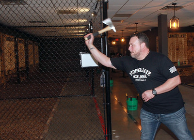 Candace H. Johnson-for Shaw Media Jason Wright, of Libertyville, owner, aims for the target as he throws a hatchet during the grand opening of the Lumberjaxe Axe Lounge on Peterson Road in Libertyville.  (10/1/21)