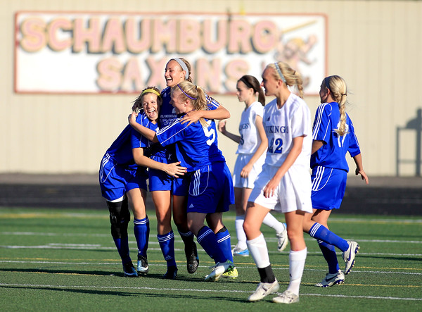 St. Charles North players Carleigh Dusek, Lauren Koehl and Natalie Winkates celebrate Koehl's goal in the first half of their sectional semifinal game at Schaumburg High School Tuesday.