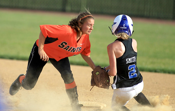 St. Charles East's Lexi Perez tags Courtney Smith of St. Charles North out at second during North 7-6 regional semifinal win Wednesday.
