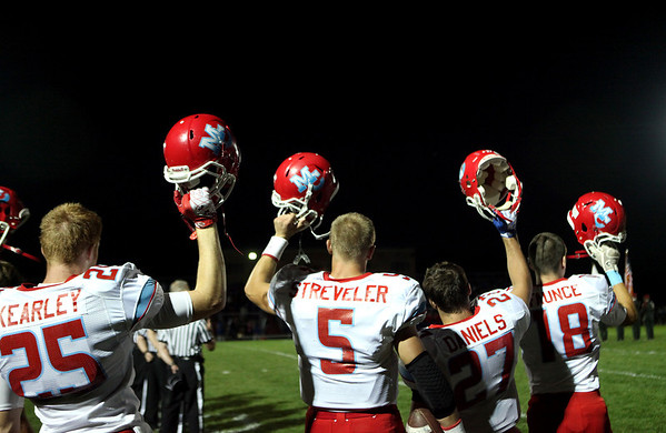 Marian Central quarterback Chris Streveler (center) lines up with his team before Friday night's game at Marmion Academy.